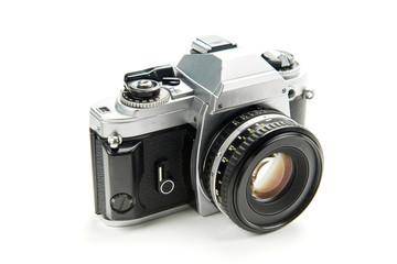 aluminum mechanical retro camera on white background