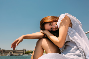 Beautiful young woman on seafront