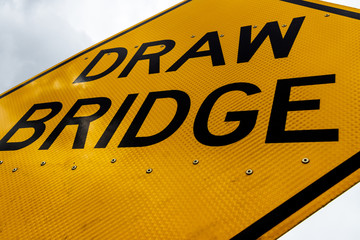 Abstract dirty dingy draw bridge sign close up