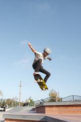 Kids having fun skating at skateboard park in the sunshine