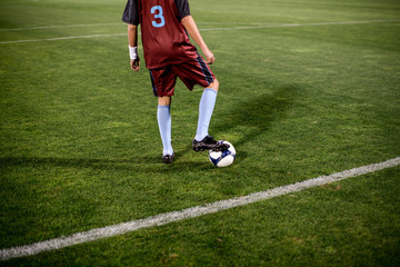 Young football player getting ready on the empty stadium