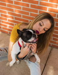 Content woman with adorable French bulldog