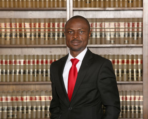 Portrait of a dynamic African American male model. Portrait of an attorney in a law office.