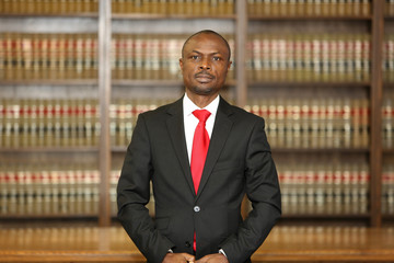 Portrait of a dynamic African American male model. Portrait of an attorney in a law office.