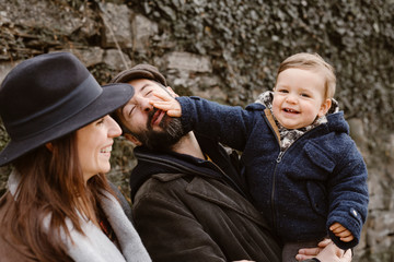 Happy family on nature in fall time