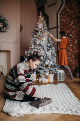 Friends at home preparing for Christmas