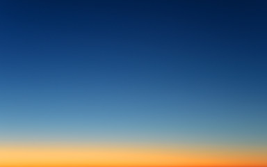 real natural color of clear winter cold sunset sky with sun below horizon line nature atmosphere panorama landscape skyline cyan background