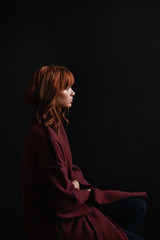 Redhead girl in red coat