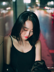 Asian young woman portrait at night in city