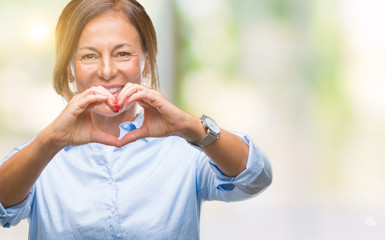 Middle age senior hispanic woman over isolated background smiling in love showing heart symbol and shape with hands. Romantic concept.
