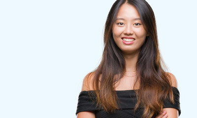 Young asian woman over isolated background happy face smiling with crossed arms looking at the camera. Positive person.