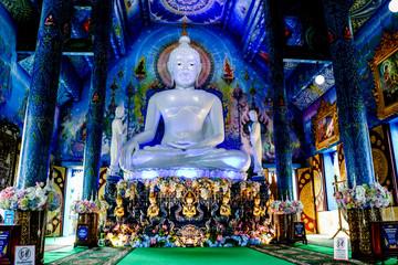 White Buddha statue in blue temple with beautiful Thai handicraft pattern.Thailand Chiang rai : 9 November 2018