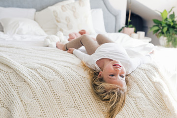 Child Playing on Bed