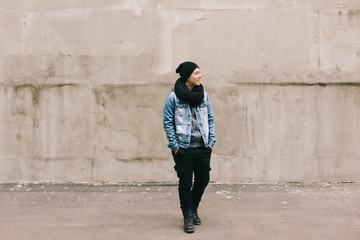 happy young androgyne woman on the street