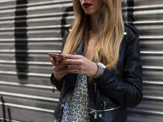 Confident stylish woman browsing phone