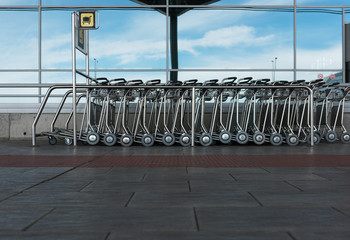 Stack of metal carts in airport