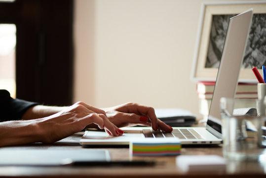 Anonymoua freelancer working on laptop