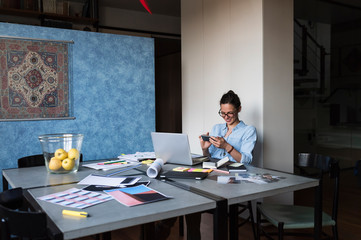 Young woman working from her studio office at home