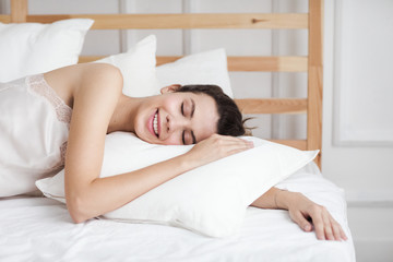 Smiling Woman Lying on Pillow