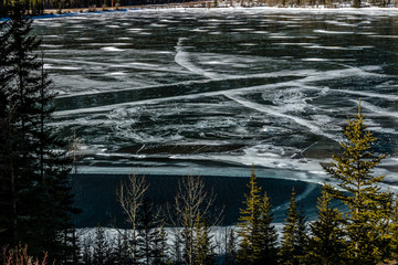 A sheen of ice still covers Barrier Lake, Bow Valley Provincial Park, Alberta, Canada
