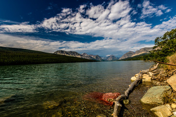 Reflections of the many glaciers in Swift current Lake, Many Glaciers, Glacier National Park, Montana, United States