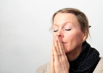 woman praying with white background