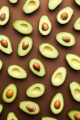 Halved avocados on brown.