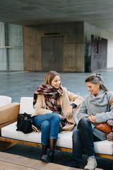 Women talking on sofa