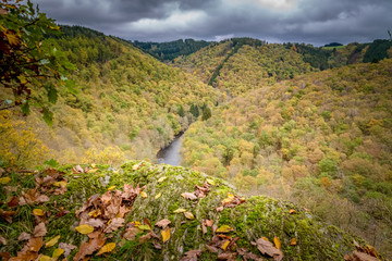 Valley of Hamteau at autumn insane colors with ourthe river Belgium