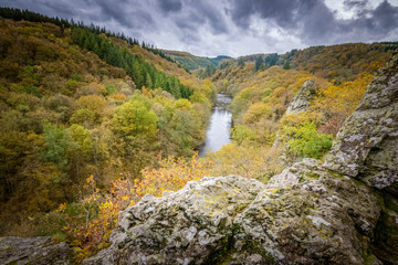 Beauitful view into the Ourthe valley at autumn time of year from rocky cliff Ardennes