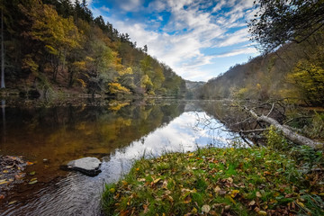 Stunning reflection and view of the Ourthe at autumn time of year Ardennes Belgium