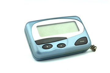 Close-up old a cyan metallic pager or beeper isolated with clipping path on white background.