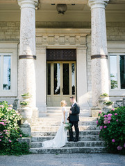Wonderful bridal couple on mansion porch