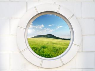 Old white antique round window