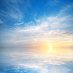 Sky background and water reflection.
