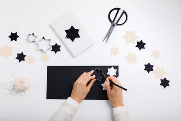 Woman draws stars for gift packages