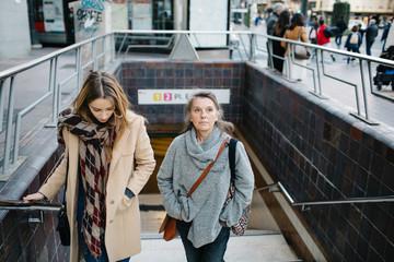 Women walking out of underground