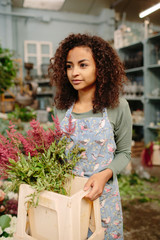 Pretty model with flowers in storage