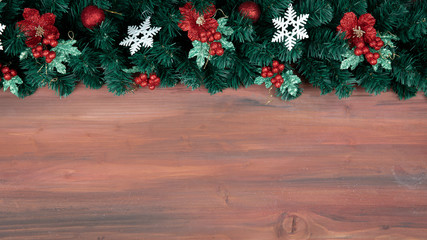 Natural wood background for copy space decorate at border with pine branches and Christmas gold ornaments,