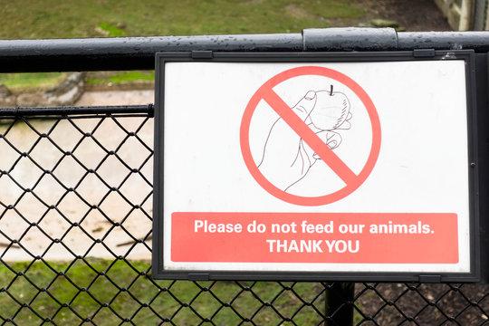 Do not feed animals donkey at London zoo sign