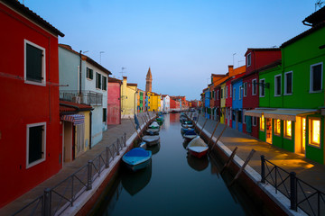 Old colorful houses and boats at night in Burano, Venice Italy