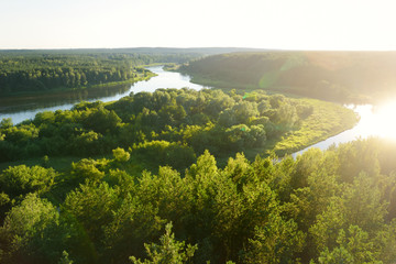 Scenic view from Merkine observation tower to Nemunas river, streaming between dense pine forests.