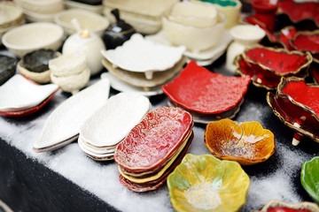 Ceramic dishes, tableware and jugs sold on Easter market in Vilnius. Lithuanian capital's traditional crafts fair is held every March on Old Town streets.