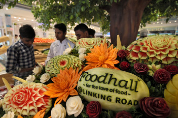 The logo of Foodhall, a premium lifestyle food superstore by India's Future Group, is seen carved in a watermelon after the inauguration of its store in Mumbai