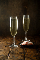 Champagne served with pink biscuits
