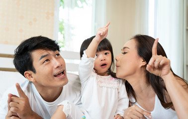Happy family playing toy at home