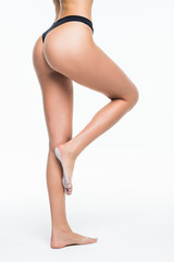 back view of a perfect long woman waxing legs and butt isolated on a white background