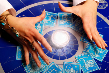 Fortune teller astrologer with astrology esoteric tools