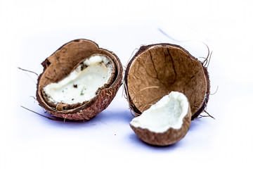 Two  cut or sliced dried coconuts isolated on white with dry flash in it.Close view.