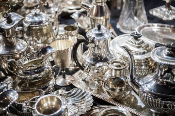 Obraz Shiny abstract background of antique silver tableware pieces in a full frame luxury jumble - fototapety do salonu